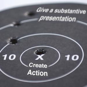 "illustration of a target with ""create action"" at bullseye"