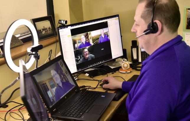 Image of Rick Clawson on video conference with Dave Case and Matt Harlow